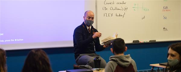 Dr. Outlaw reading to a class of students